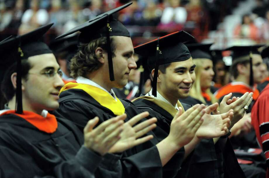 Graduates applaud the speakers during RPI college commencement on Saturday, May 25, 2013, at Rensselaer Polytechnic Institute in Troy, N.Y. (Cindy Schultz / Times Union) Photo: Cindy Schultz / 10022129A