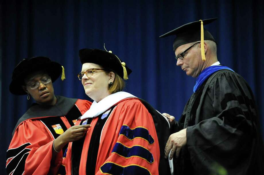 Patricia Stonesifer, center, receives an Honorary Doctor of Humane Letters during RPI college commencement on Saturday, May 25, 2013, at Rensselaer Polytechnic Institute in Troy, N.Y. (Cindy Schultz / Times Union) Photo: Cindy Schultz / 10022129A