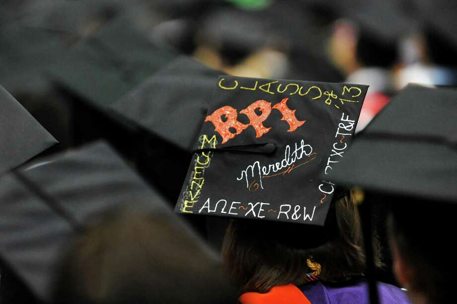 A graduate shows her flair during RPI college commencement on Saturday, May 25, 2013, at Rensselaer Polytechnic Institute in Troy, N.Y. (Cindy Schultz / Times Union) Photo: Cindy Schultz / 10022129A