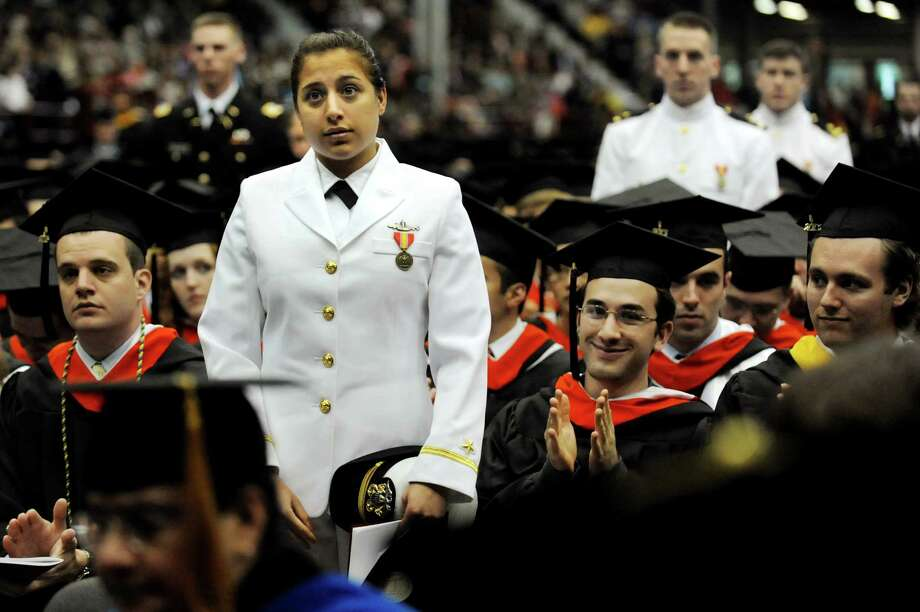 Graduates in the military stand for recognition during RPI college commencement on Saturday, May 25, 2013, at Rensselaer Polytechnic Institute in Troy, N.Y. (Cindy Schultz / Times Union) Photo: Cindy Schultz / 10022129A