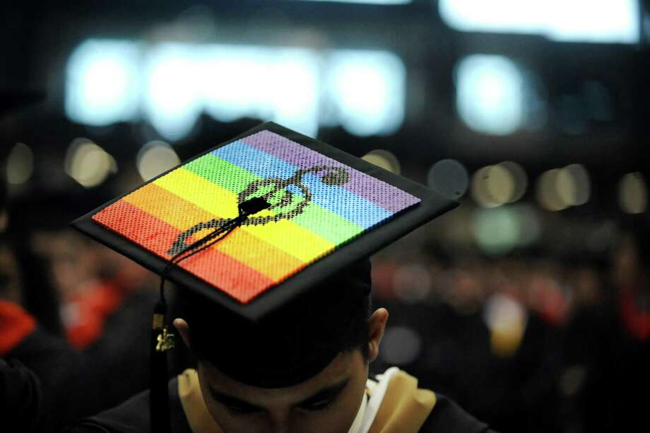 A graduate shows his passion on his mortar board during RPI college commencement on Saturday, May 25, 2013, at Rensselaer Polytechnic Institute in Troy, N.Y. (Cindy Schultz / Times Union) Photo: Cindy Schultz / 10022129A