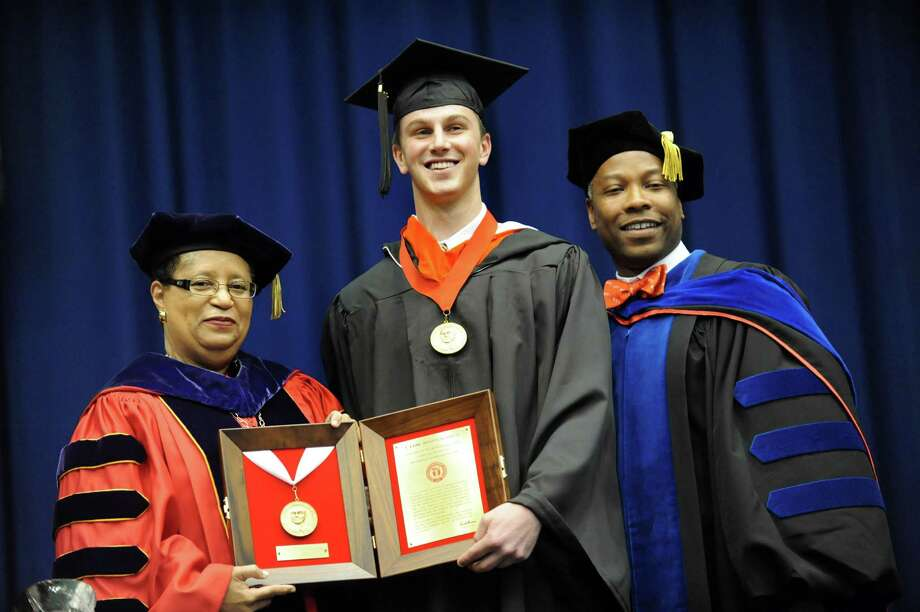 Graduate Adam Patenaude, center, poses with President Shirley Ann Jackson, left, and Timothy Sams, vice president of student life, during RPI college commencement on Saturday, May 25, 2013, at Rensselaer Polytechnic Institute in Troy, N.Y. Patenaude received the J. Erik Jonsson Prize for high academic achievement. (Cindy Schultz / Times Union) Photo: Cindy Schultz / 10022129A