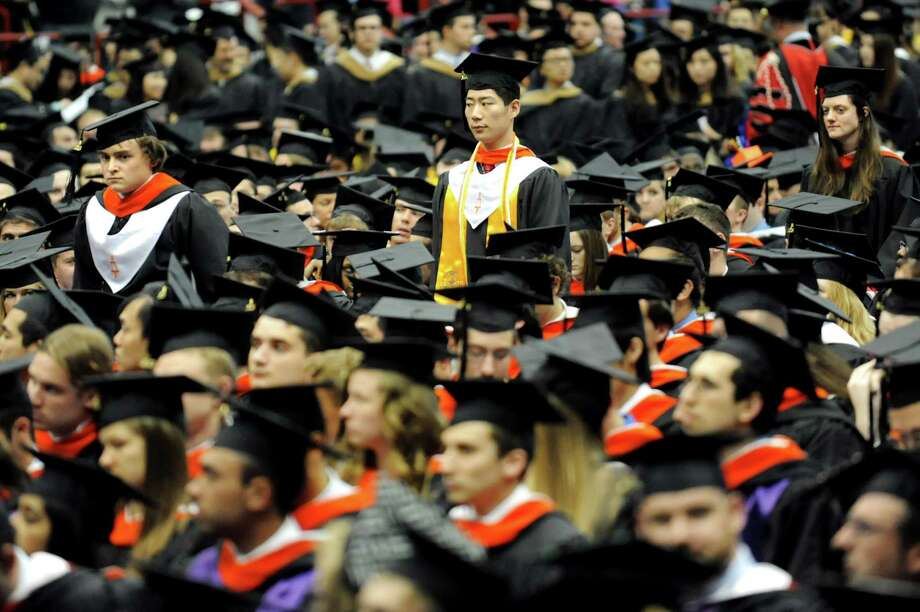 Graduates approach the stage to receive their diplomas during RPI college commencement on Saturday, May 25, 2013, at Rensselaer Polytechnic Institute in Troy, N.Y. (Cindy Schultz / Times Union) Photo: Cindy Schultz / 10022129A