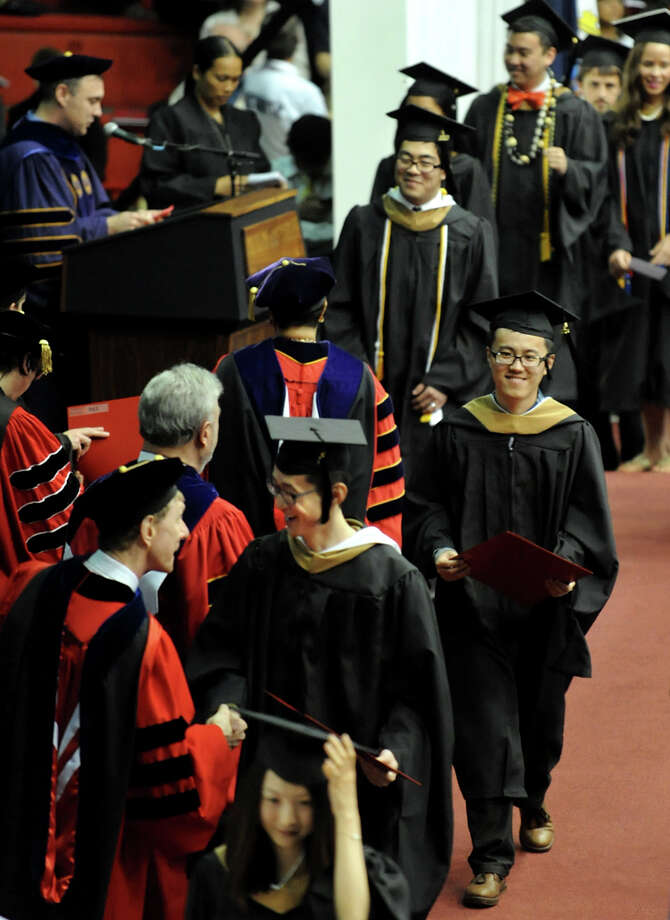 Graduates receive their diplomas during RPI college commencement on Saturday, May 25, 2013, at Rensselaer Polytechnic Institute in Troy, N.Y. (Cindy Schultz / Times Union) Photo: Cindy Schultz / 10022129A