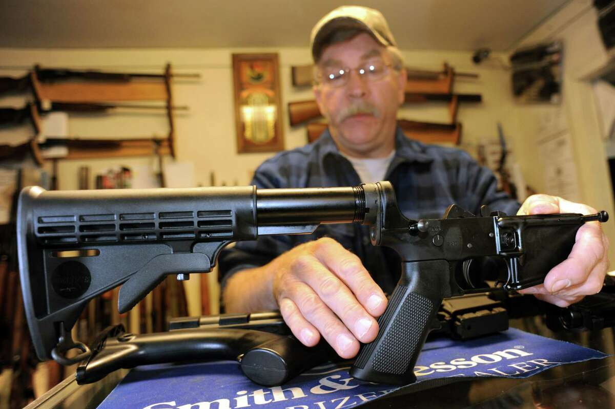 Shop owner Rich Sehlmeyer holds an illegal AR-15 assault-style rifle pistol grip on Saturday, May 25, 2013, at The Gun Shop in Lake Luzerne, N.Y. (Cindy Schultz / Times Union)