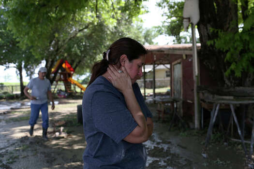 Celia Olivarez sees the damage to her home which had several feet of floodwater in it on Espada Rd. on Saturday, May 25, 2013. 54 people were rescued from the neighborhood. Photo: Lisa Krantz, San Antonio Express-News / San Antonio Express-News