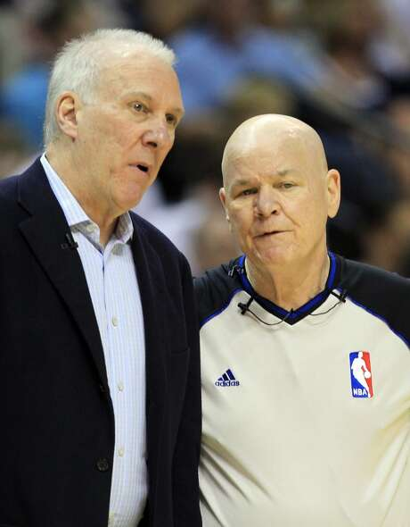 Head coach Gregg Popovich of the San Antonio Spurs talks with referee Joe Crawford #17 in the first quarter during Game Three of the Western Conference Finals of the 2013 NBA Playoffs at the FedExForum on May 25, 2013 in Memphis, Tennessee. (Ronald Martinez / Getty Images)