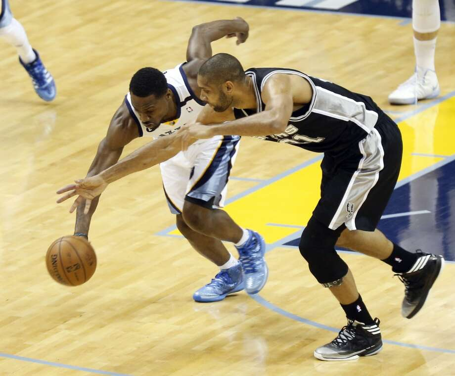 Grizzlies guard Tony Allen (9) steals the ball as Spurs forward Tim Duncan (21) tries to recover during the first half of Game 3 in their NBA basketball Western Conference finals playoff series, Saturday, May 25, 2013, in Memphis, Tenn. (Rogelio Solis / Associated Press)