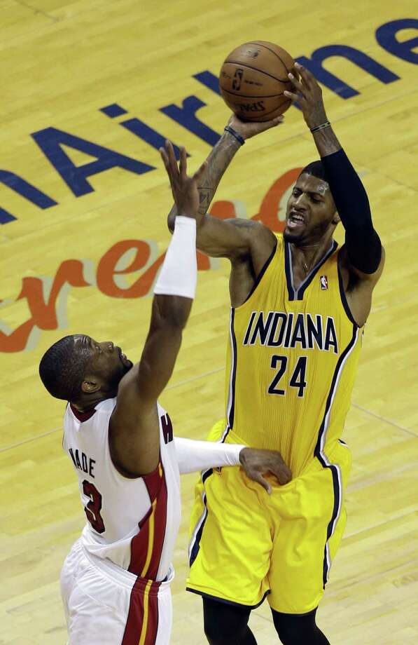 Pacers forward Paul George, shooting over the Heat's Dwyane Wade, averaged 24.5 points and 5.5 assists as Indiana stole home-court advantage with a split of two games in Miami. Photo: Alan Diaz / Associated Press