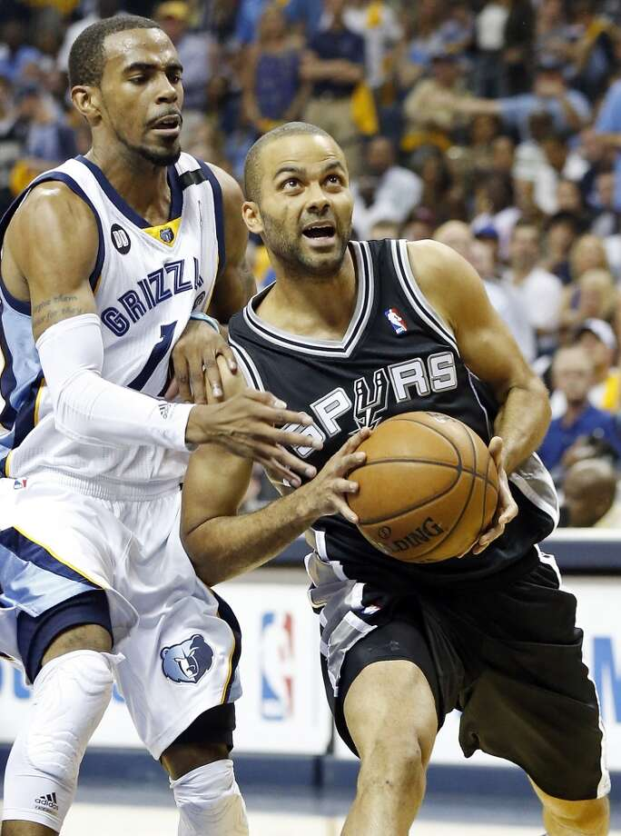 The Spurs' Tony Parker looks for room around the Grizzlies' Mike Conley during first half action in Game 3 of the 2013 Western Conference finals Saturday, May 25, 2013 at the FedEx Forum in Memphis, Tenn. (Edward A. Ornelas / San Antonio Express-News)