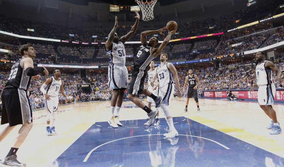 The Spurs' Kawhi Leonard (02) goes up for a shot against the Grizzlies' Zach Randolph (50) in the first half of Game 3 of the 2013 Western Conference Finals at the FedEx Forum in Memphis on Saturday, May 25, 2013. (Kin Man Hui/San Antonio Express-News)