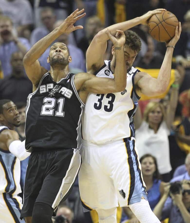 The Spurs' Tim Duncan (21) competes for a rebound against the Grizzlies' Marc Gasol (33) in the first half of Game 3 of the 2013 Western Conference Finals at the FedEx Forum in Memphis on Saturday, May 25, 2013. (Kin Man Hui / San Antonio Express-News)
