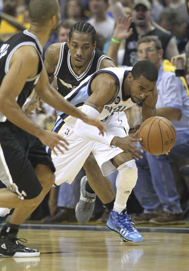 The Grizzlies' Mike Conley (11) gets a steal against Spurs' Kawhi Leonard (2) in the first half of Game 3 of the 2013 Western Conference Finals at the FedEx Forum in Memphis on Saturday, May 25, 2013. (Kin Man Hui / San Antonio Express-News)