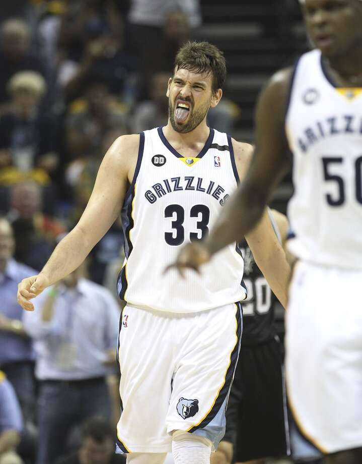 The Grizzlies' Marc Gasol (33) sticks out his tongue after getting hit in the face in the first half of Game 3 of the 2013 Western Conference Finals at the FedEx Forum in Memphis on Saturday, May 25, 2013. (Kin Man Hui / San Antonio Express-News)
