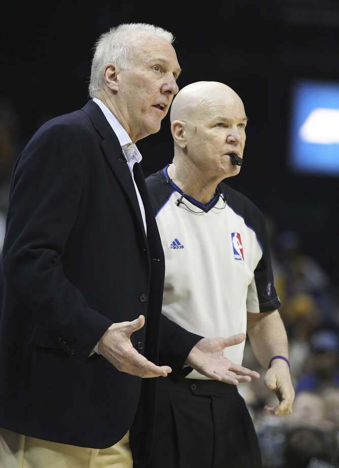 Spurs coach Gregg Popovich talks with game official Joe Crawford during Game 3 against the Memphis Grizzlies in the first half of the 2013 Western Conference Finals at the FedEx Forum in Memphis on Saturday, May 25, 2013. (Kin Man Hui / San Antonio Express-News)