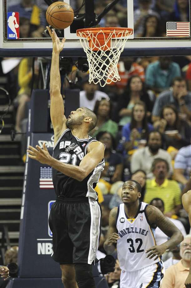 The Spurs' Tim Duncan (21) gets a put back against the Grizzlies' Ed Davis (32) in the first half of Game 3 of the 2013 Western Conference Finals at the FedEx Forum in Memphis on Saturday, May 25, 2013. (Kin Man Hui / San Antonio Express-News)