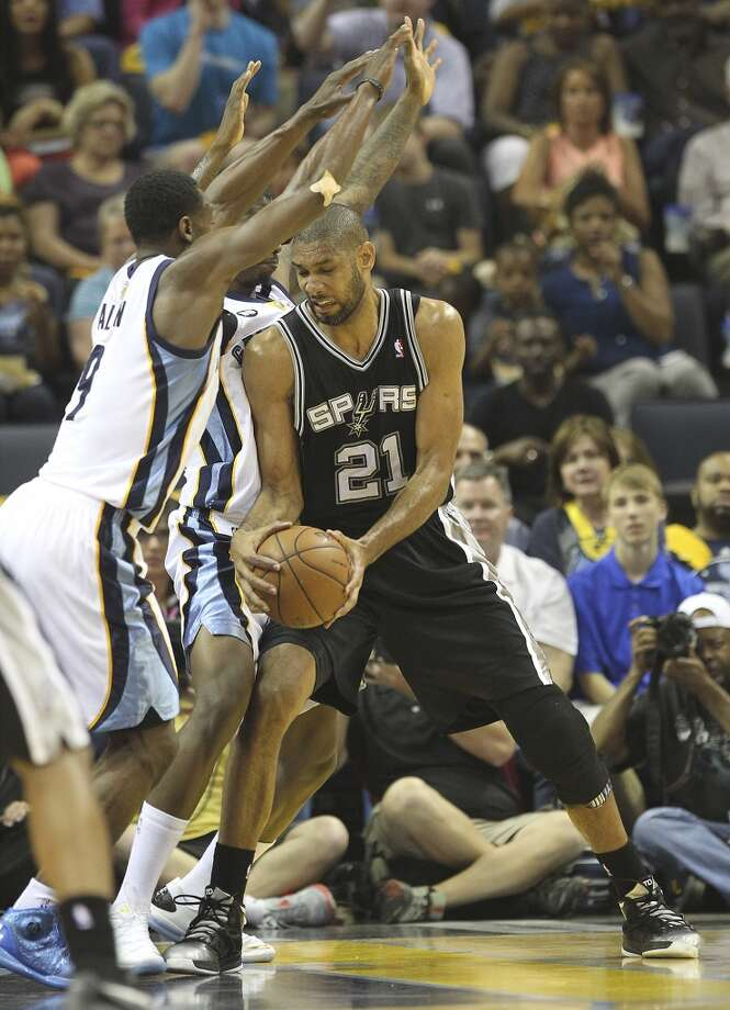 The Spurs' Tim Duncan (21) is pressured by the Grizzlies' Tony Allen (9) and Ed Davis (32) in the first half of Game 3 of the 2013 Western Conference Finals at the FedEx Forum in Memphis on Saturday, May 25, 2013. (Kin Man Hui / San Antonio Express-News)