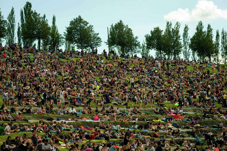 For the second day in a row, colorfully-dressed attendees make the trek from the campground to the hills overlooking the Columbia River to enjoy artists spanning across multiple stages during the second day of the annual Sasquatch music festival Saturday, May 25, 2013, at The Gorge Amphitheatre in George. Photo: JORDAN STEAD, SEATTLEPI.COM / SEATTLEPI.COM