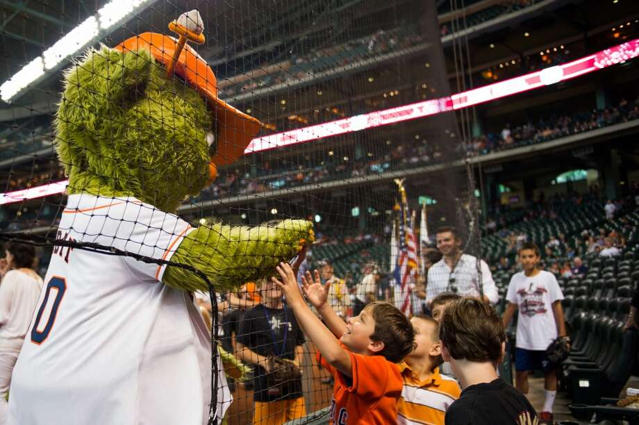 Astros mascot Orbit plays with young fans before the game against the Athletics.