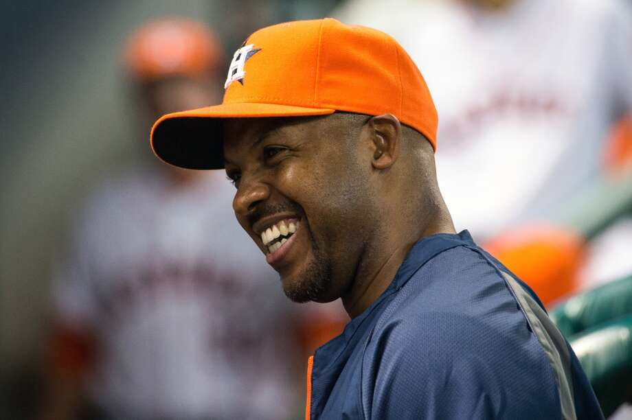 Astros manager Bo Porter laughs in the dugout before the game.