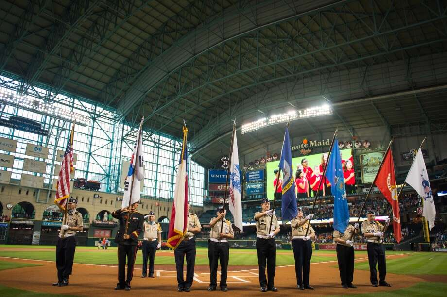 The Korean War Veterans Texas  Lone Star Chapter present the colors before the Astros game against the Athletics.