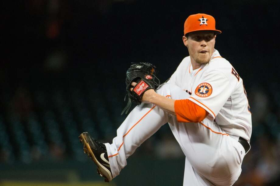 Astros starting pitcher Lucas Harrell pitches during the first inning.