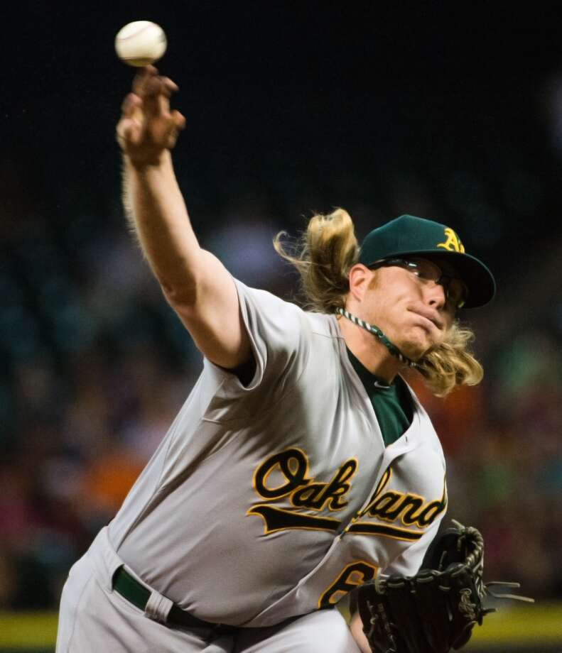 Athletics starting pitcher A.J. Griffin throws a pitch during the first inning.
