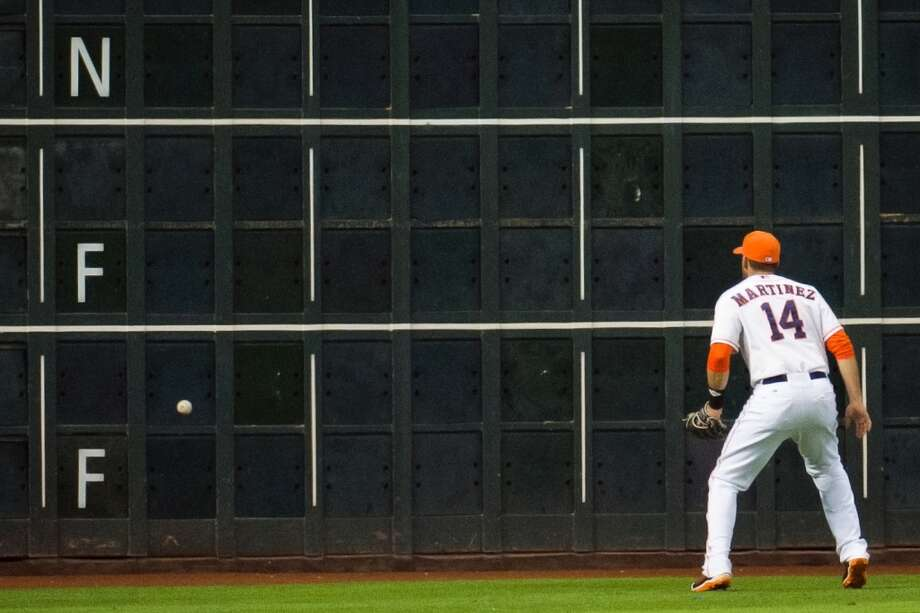 Astros left fielder J.D. Martinez plays the ball off the wall on a double by Athletics outfielder Chris Young.