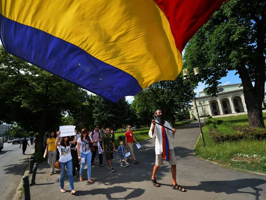 A protester waves a Romanian flag during a demonstration against anti-genetically modified organism (GMOs) and US chemical giant Monsanto in Bucharest May 25, 2013.