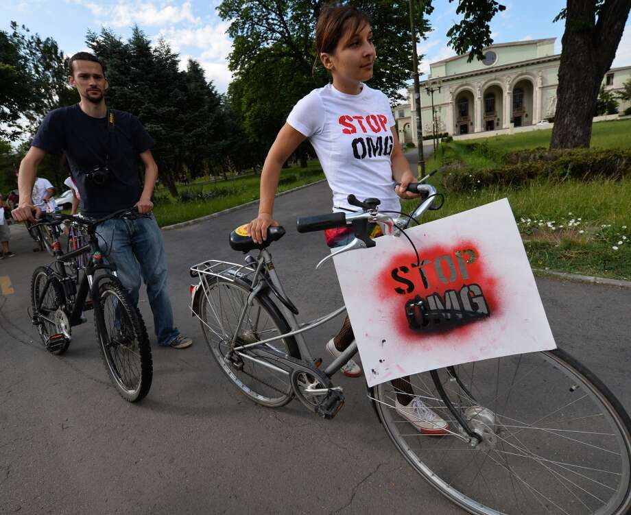 "A protester wears a shirt reading ""STOP GMOs"" during a demonstration against anti-genetically modified organism (GMOs) and US chemical giant Monsanto in Bucharest May 25, 2013."