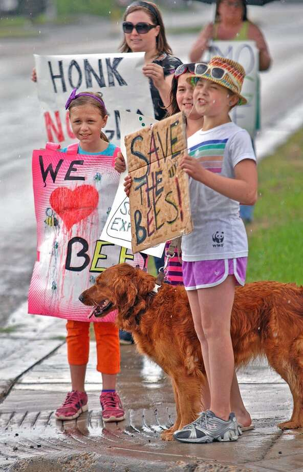 "Sadie Irelan, 9, Nola Demars, 10, and Saffron Kulackoski, 10, along with others, gather in front of the State Capitol, Saturday, May 25, 2013 in Bismarck, N.D. Organizers say two million people marched in protest against seed giant Monsanto in hundreds of rallies across the U.S. and in over 50 other countries on Saturday. ""March Against Monsanto"" protesters say they wanted to call attention to the dangers posed by genetically modified food and the food giants that produce it. Founder and organizer Tami Canal said protests were held in 436 cities in 52 countries."