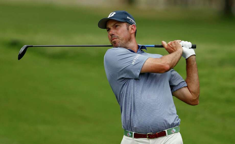 FORT WORTH, TX - MAY 25: Matt Kuchar hits his approach shot on the first hole during the third round of the Crowne Plaza Invitational at Colonial Country Club on May 25, 2013 in Fort Worth, Texas. (Photo by Scott Halleran/Getty Images) Photo: Scott Halleran