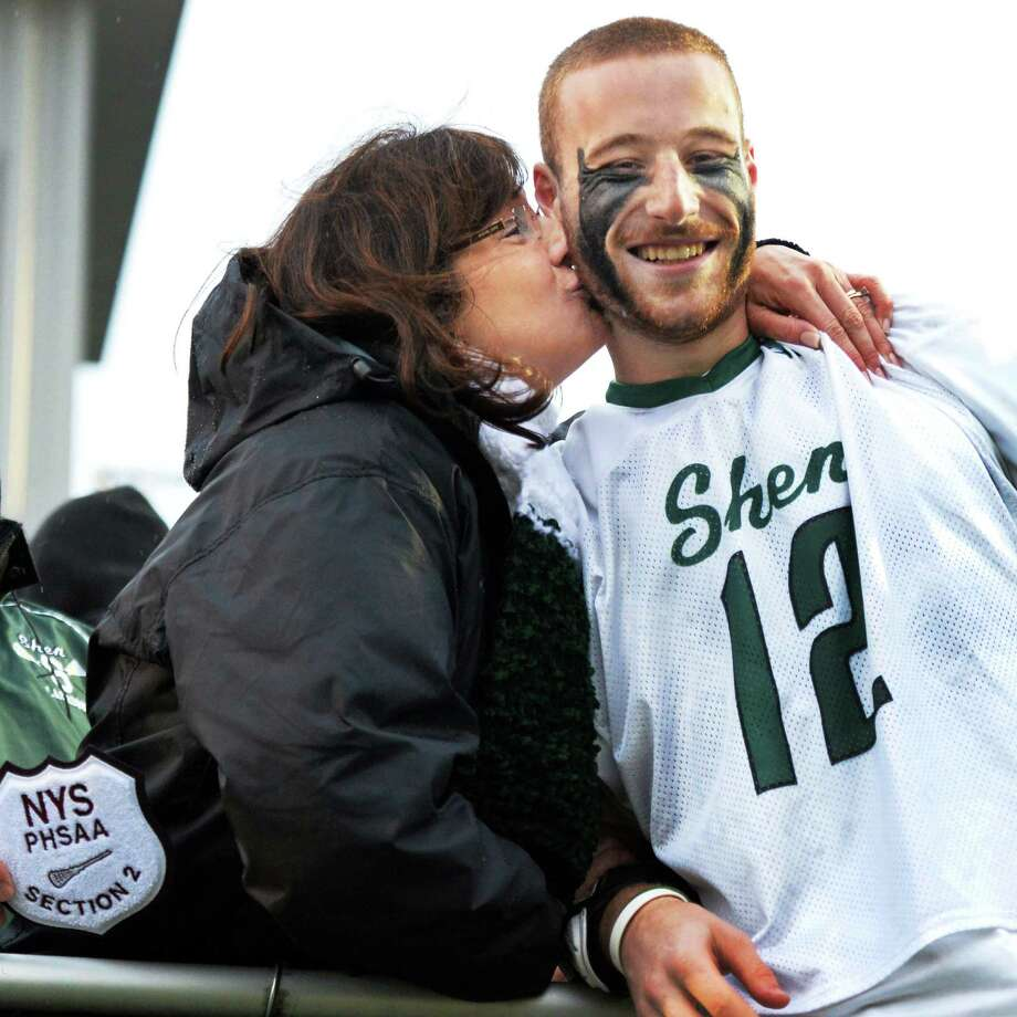 Shen's Brian Rogers gets a kiss from mom Eilleen Rogers after their win over Shaker High in Section II Class A boys' lacrosse championship game at UAlbany in Albany, NY, Saturday May 25, 2013.  (John Carl D'Annibale / Times Union) Photo: John Carl D'Annibale / 00022509A