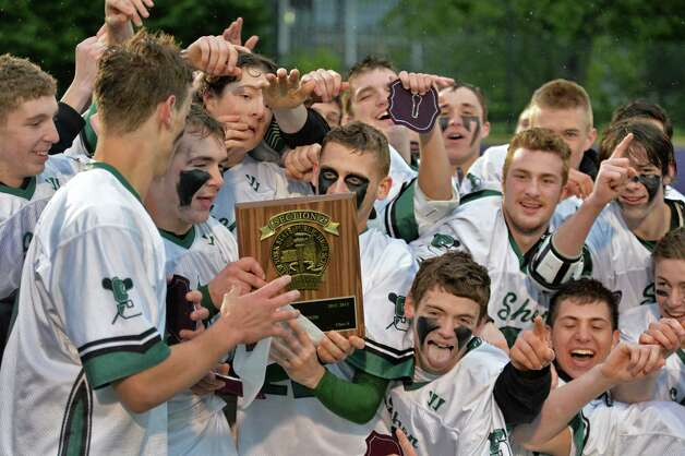 Shen players celebrate their win over Shaker High in Section II Class A boys' lacrosse championship game at UAlbany in Albany, NY, Saturday May 25, 2013.  (John Carl D'Annibale / Times Union) Photo: John Carl D'Annibale / 00022509A