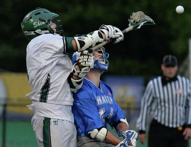 Shen's #2, D.J. Edick gets a pass by Shaker defender #13 Nick Dodd during the  Section II Class A boys' lacrosse championship game at UAlbany in Albany, NY, Saturday May 25, 2013.  (John Carl D'Annibale / Times Union) Photo: John Carl D'Annibale / 00022509A