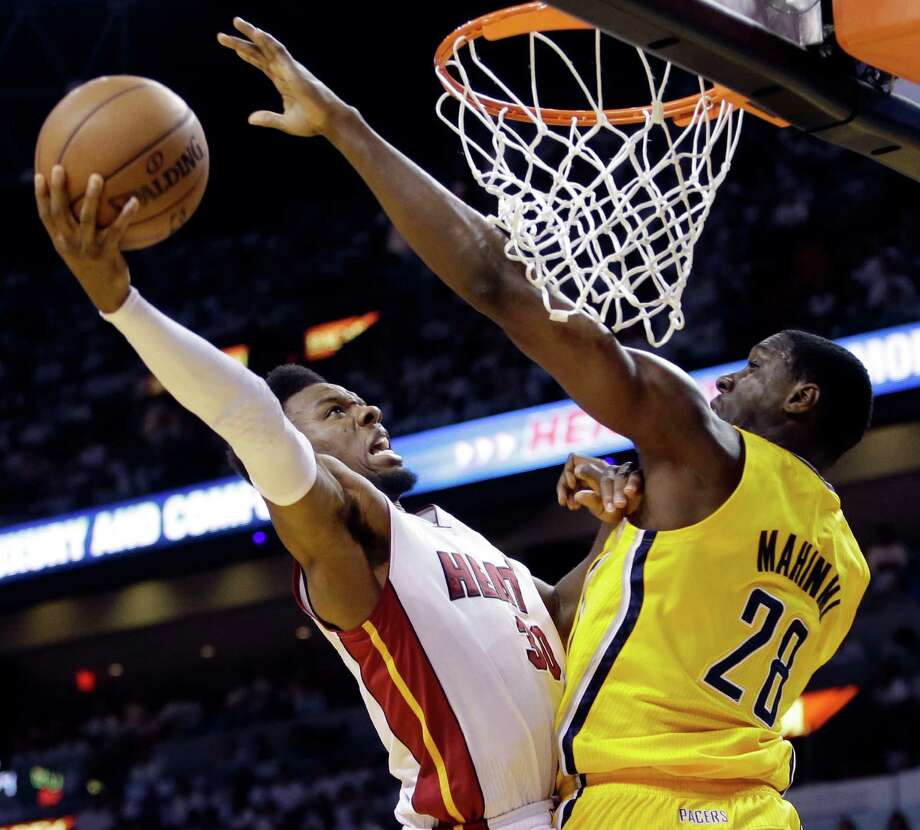 Miami Heat guard Norris Cole (30) attempts to score around Indiana Pacers center Ian Mahinmi (28) during the second half of Game 2 in their NBA basketball Eastern Conference finals playoff series, Friday, May 24, 2013, in Miami. (AP Photo/Lynne Sladky) Photo: Lynne Sladky