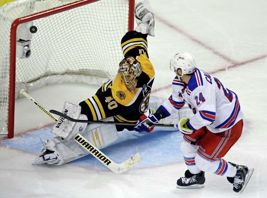 Boston Bruins goalie Tuukka Rask (40) makes a save on a breakaway by New York Rangers right wing Ryan Callahan (24) during the third period in Game 5 of the Eastern Conference semifinals in the NHL hockey Stanley Cup playoffs in Boston, Saturday, May 25, 2013. (AP Photo/Charles Krupa) Photo: Charles Krupa