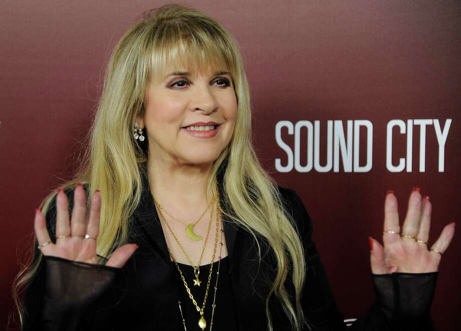 "Singer Stevie Nicks waves to photographers at the premiere of the documentary film ""Sound City"" on Thursday, Jan. 31, 2013 in Los Angeles. (Photo by Chris Pizzello/Invision/AP Images) Photo: Chris Pizzello / Invision"