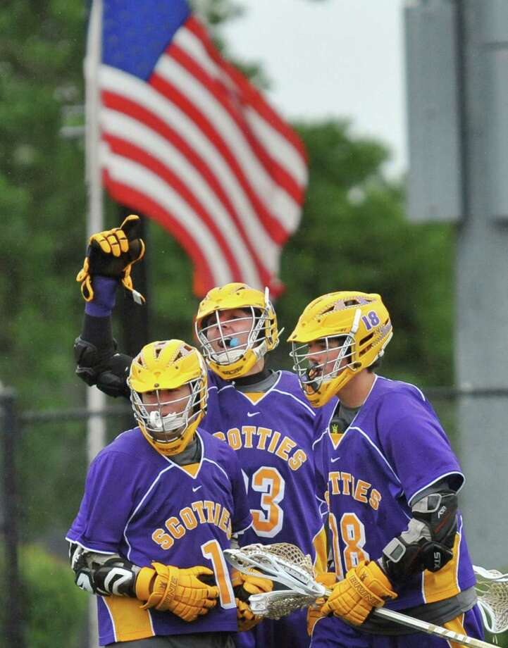Ballston Spa players, from left, #1Sam Groves, #23 Jake Gargiulo and #18 Coltin Moseman celebrate Gargiulo's goal against Niskayuna during the Section II Class B boys' lacrosse championship game at UAlbany in Albany, NY, Saturday May 25, 2013.  (John Carl D'Annibale / Times Union) Photo: John Carl D'Annibale / 00022508A