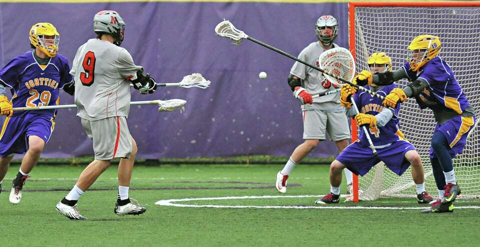 Niskayuna's #9 Luke Goldstock takes a shot as Ballston Spa's goalie #4 Jon Blake and #19 	Carter Ric
