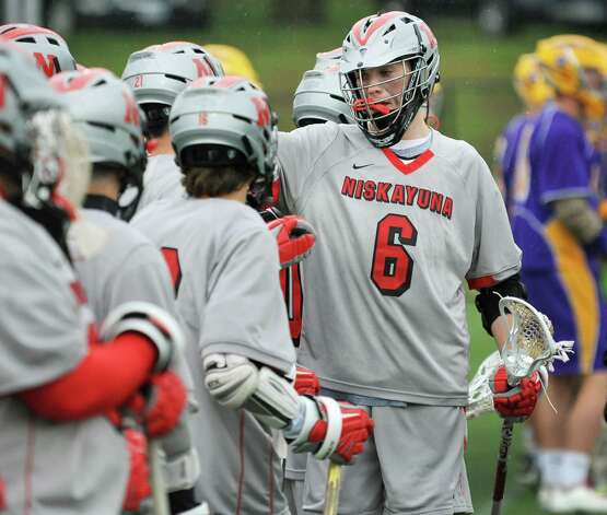 Niskayuna's #6 Ryan Lawson is congratulated by teammates after his first quarter goal against Ballston Spa during the Section II Class B boys' lacrosse championship game at UAlbany in Albany, NY, Saturday May 25, 2013.  (John Carl D'Annibale / Times Union) Photo: John Carl D'Annibale / 00022508A