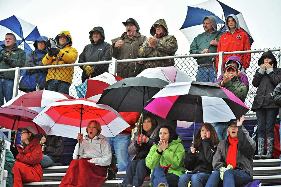 Niskayuna fans brave a cold rain to cheer their team on against Ballston Spa during the Section II Class B boys' lacrosse championship game at UAlbany in Albany, NY, Saturday May 25, 2013.  (John Carl D'Annibale / Times Union) Photo: John Carl D'Annibale / 00022508A