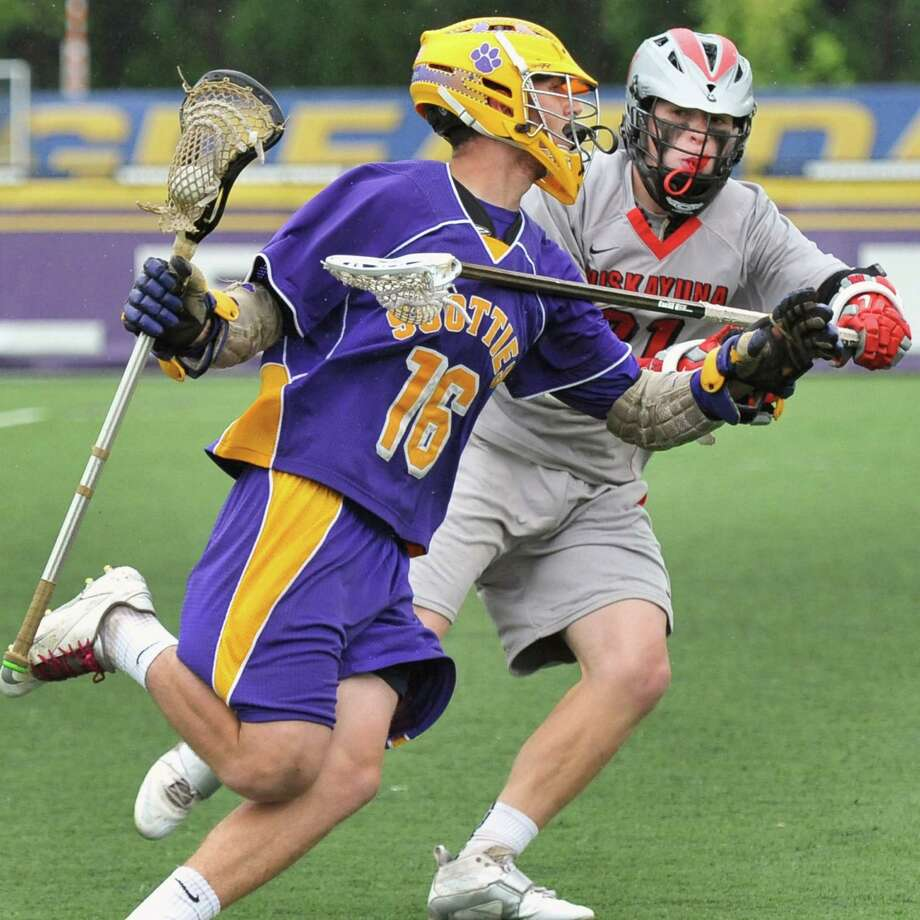 Ballston Spa's #16, Garrett O'Grady, left, and Niskayuna's #31 Caneron Pierce during the Section II Class B boys' lacrosse championship game at UAlbany in Albany, NY, Saturday May 25, 2013.  (John Carl D'Annibale / Times Union) Photo: John Carl D'Annibale / 00022508A