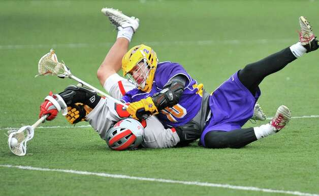 Niskayuna's #22 Dyan Pantalone, left, and Ballston Spa's #10 Skyler McConchie tangle during the Section II Class B boys' lacrosse championship game at UAlbany in Albany, NY, Saturday May 25, 2013.  (John Carl D'Annibale / Times Union) Photo: John Carl D'Annibale / 00022508A