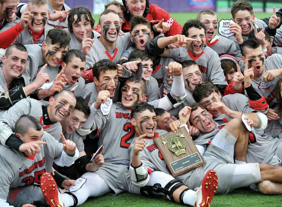 Niskayuna players celebate their victory over Ballston Spa for the Section II Class B boys' lacrosse championship game at UAlbany in Albany, NY, Saturday May 25, 2013.  (John Carl D'Annibale / Times Union) Photo: John Carl D'Annibale / 00022508A
