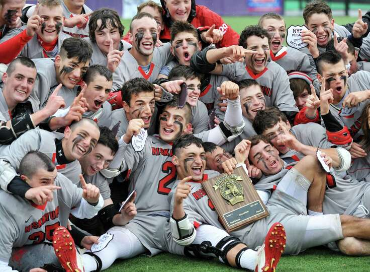 Niskayuna players celebate their victory over Ballston Spa for the Section II Class B boys' lacrosse