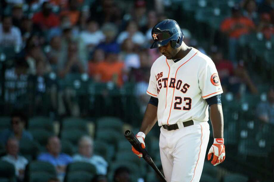 Chris Carter has had his ups and downs in his first year with the Astros, which has come with an everyday job, but it's the depths of the strikeout-laden valleys that have the coaching staff stressing the importance of consistency. Photo: Smiley N. Pool / © 2013  Smiley N. Pool
