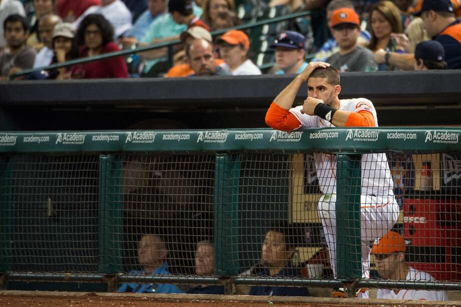 Houston Astros outfielder J.D. Martinez watches from the dugout at the Astros bat during the eighth inning.