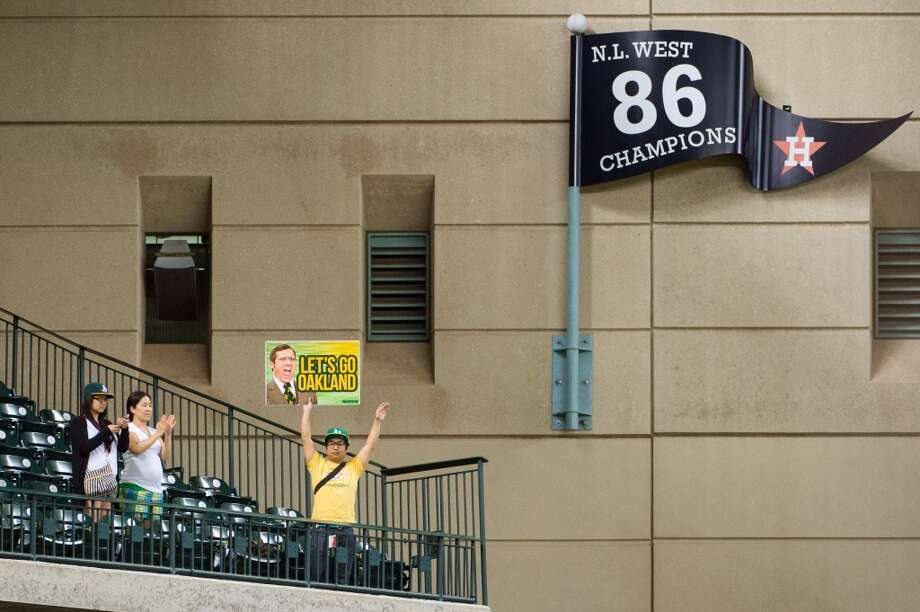 Oakland fans cheer the final out of a 11-5 victory over the Astros at Minute Maid Park.