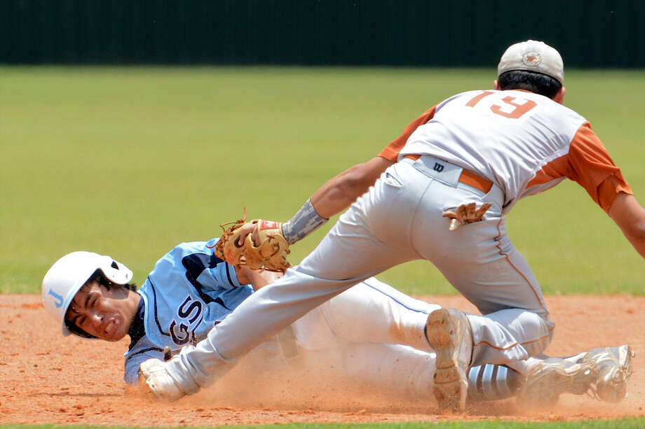 Johnson's Nick Mireles is tagged out by Eagle Pass shortstop Eric Gonzalez while trying to steal second during Game 2 of their Region IV-5A semifinal. Photo: John Albright / For The Express-News